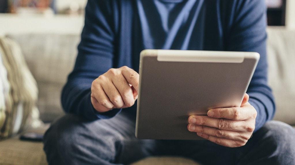 man-on-tablet-1200