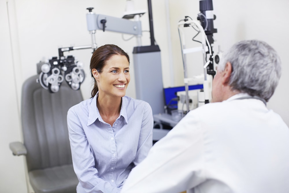 An ophthalmologist talking through the informed consent with a patient