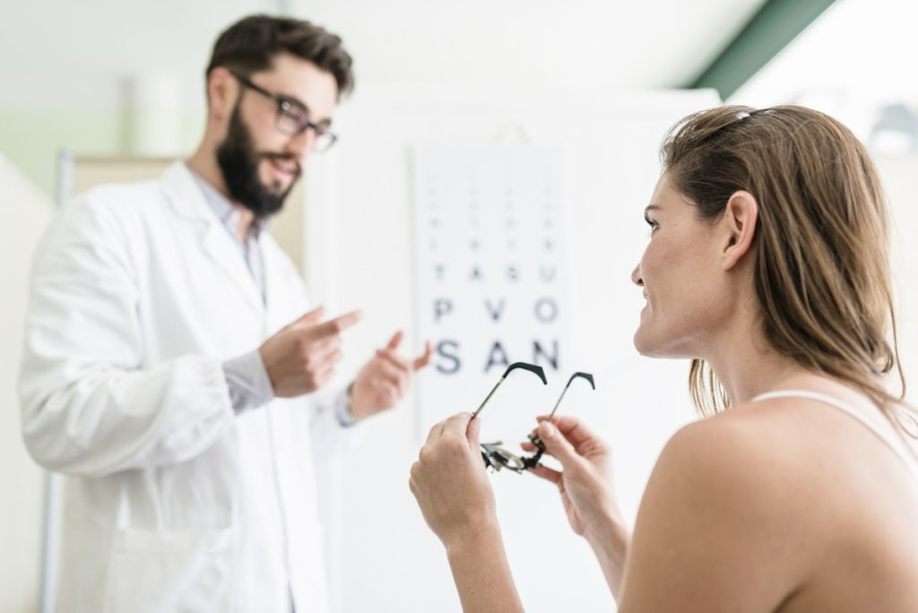 Ophthalmologist doctor talking with the patient about how LASIK has never been better